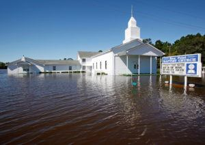 A Baptist church is surrounded by flood waters after Hurricane Matthew hit Lumberton, North Carolina October 9, 2016. REUTERS/Jonathan Drake