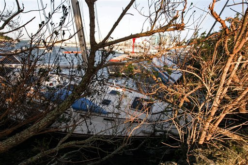 Yachts that have broken way from their moorings sit on a rock in Hamilton Harbor after Hurricane Gonzalo hit the island in Hamilton, Bermuda,  Saturday Oct. 18, 2014. The storm's center crossed over Bermuda Friday night.(AP Photo/David Skinner)