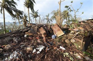 Destroyed family home in Port Vila, Vanuatu in the aftermath of Cyclone Pam Monday, March 16, 2015. (AP Photo/Dave Hunt, Pool)