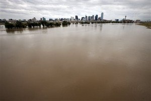 The rain-swollen Trinity River is seen leading up to the city skyline Saturday, Oct. 24, 2015, in Dallas. Southeast Texas was bracing for heavy rain late Saturday and into Sunday as the remnants of Hurricane Patricia combined with a powerful storm system that's been moving across Texas, flooding roads and causing a freight train to derail. (AP Photo/Tony Gutierrez)