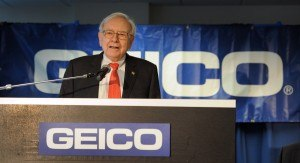 Warren Buffett, Chairman, President & CEO of Berkshire Hathaway, delivers his address during the official ribbon cutting and opening of GEICO's new call center Monday morning, July 22, 2013 in Carmel, Ind.  Buffett joined Gov. Mike Pence and GEICO executives for the morning ribbon-cutting. (AP Photo/The Star, Matt Kryger)