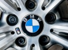 MUNCHEN GERMANY - APRIL 06 2015: BMW electric limousine alloy wheel detail with logotype of BMW on it