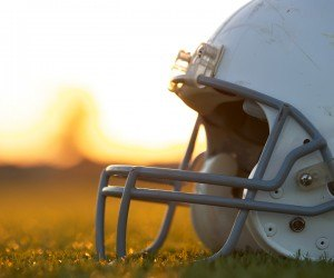 American Football Helmet on the Field at Sunset with room for co