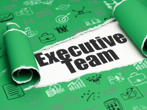 Business concept: black text Executive Team under the curled piece of Green torn paper with Hand Drawn Business Icons