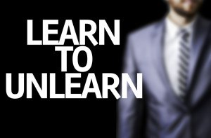 Business man with the text Learn to Unlearn in a concept image