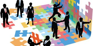 Business people collaborate to put pieces together find solution