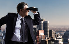 Businessman with binoculars. Search concept.