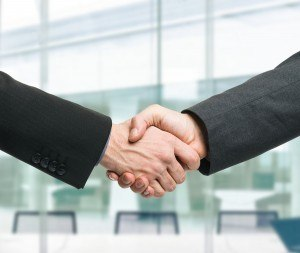bigstock-Businessmen-shaking-hands-to-s-42928921-merger-hired-hiring