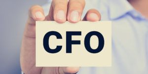 CFO letters (or Chief Financial Officer) on the card held by a man hand vintage tone