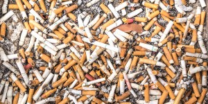 BANGKOK,THAILAND - MARCH 7 2015: ashtray filled of cigarettes.Many governments impose restrictions on smoking tobacco especially in public areas. The primary justification has been the negative health effects of second-hand smoke