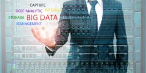 Double exposure of businessman holding big data information and server storage in data center IT Business concept