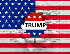 closeup of grunge American USA flag broken crack wall with hole and word trump united states of america vote for president trump concept