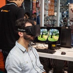 Man wearing virtual reality headset Games Week 2013 in Milan