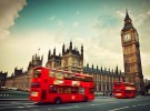 London, the UK. Red bus in motion and Big Ben, the Palace of Wes