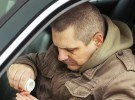 bigstock-Man-sitting-in-car-with-drugs--42326815