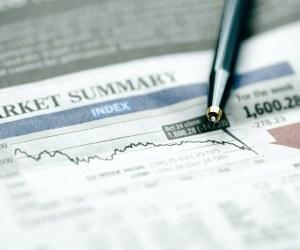 Pen on graph chart of falling stock market