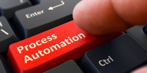 Process Automation Button. Male Finger Clicks on Red Button on Black Keyboard. Closeup View. Blurred Background. 3D Render.