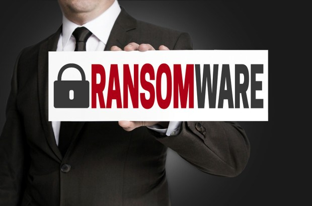 ransomware protection is held by businessman background