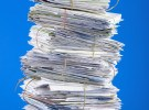 Pile of envelopes letters bills forms. Isolated on blue