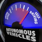 The words Autonomous Vehicles on an automobile gauge with the ne