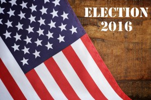 USA 2016 Presidential Election with American Stars and Stripes flag on wood background with added text.